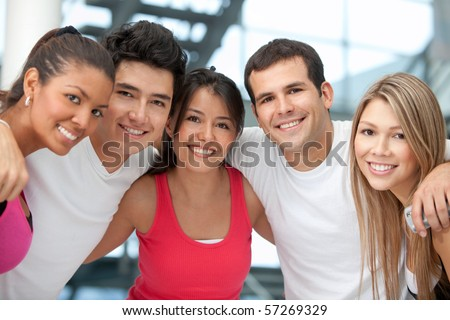 Group of athletic young people at the gym smiling - stock photo