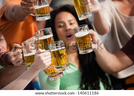 Group of Attractive young People toasting with a delicious Pale Ale  Beer - stock photo