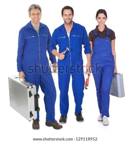 Group of automechanic. Isolated on white background - stock photo