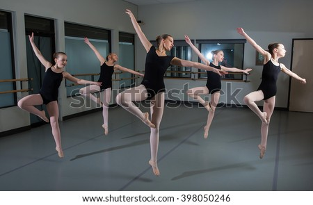 Group of ballet dancers jumping in the air - stock photo