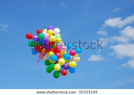 group of balloons flying in the sky - stock photo