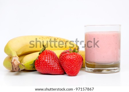 Group of bananas and strawberries with a shake of strawberries and milk on a white background. - stock photo