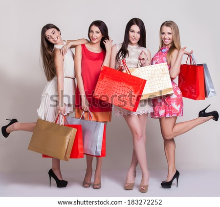 Group of beautiful shopping women with bags - stock photo