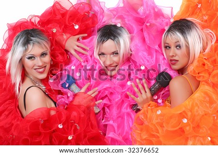 Group of beautiful young women in bright theatrical suits, isolated on a white background, please see some of my other parts of a body images