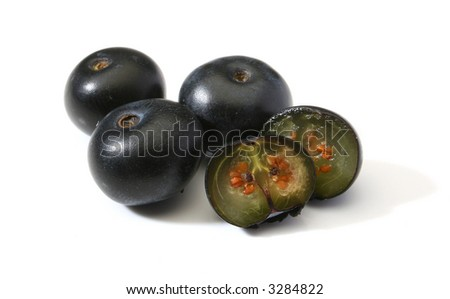 Group of black currants, one sliced in half - stock photo