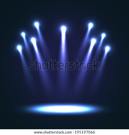 Group of blue bright projectors for scene lighting decoration on black background. Special light effects - stock photo