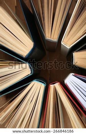 Group of books on wooden planks background, top view - stock photo