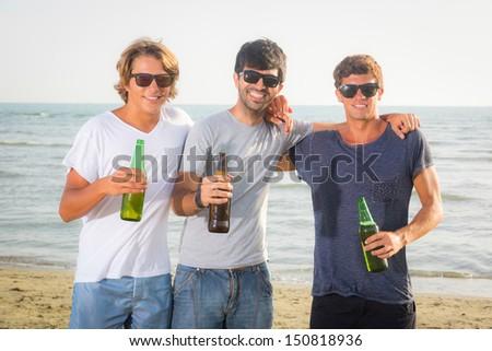 Group of Boys Cheering at Beach - stock photo