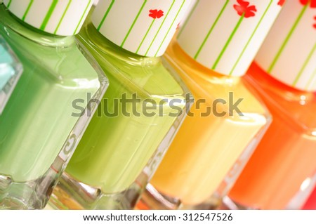 Group of bright nail polishes isolated on white background.