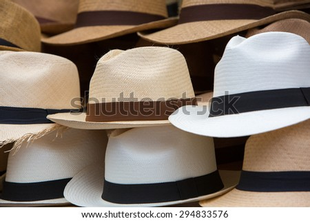 Group of brown hats for sale, hanging on a wall, Otavalo Market. Ecuador - stock photo