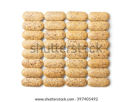 Group of brown pills isolated on white
