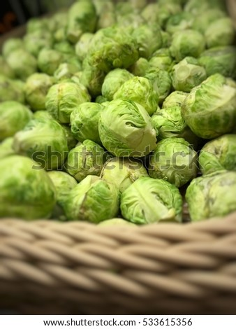 Group of Brussels sprouts in basket selected focus