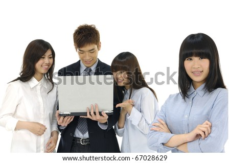 Group of business colleagues working together on a laptop focus of pretty business woman young woman