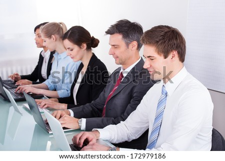 Group Of Business Executives Sitting In A Row - stock photo