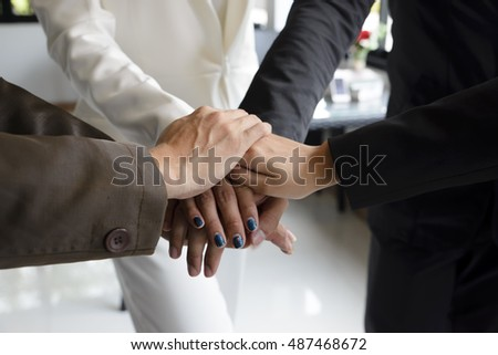 Group of business hands together in office.