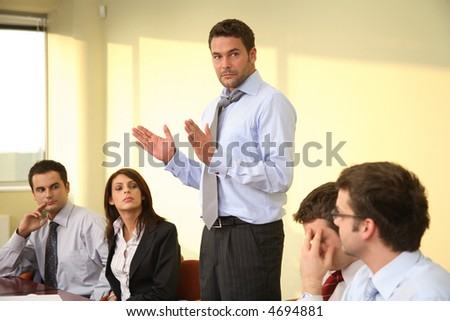 Group of business listening to their boss during informal meeting - stock photo