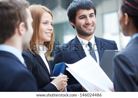Group of business partners negotiating at meeting - stock photo