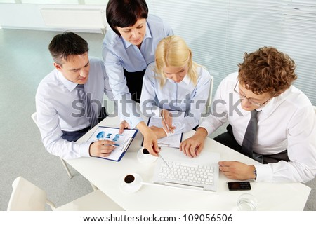 Group of business partners planning work at meeting