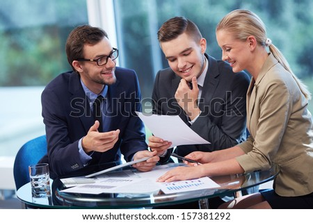 Group of business partners working with documents in office - stock photo