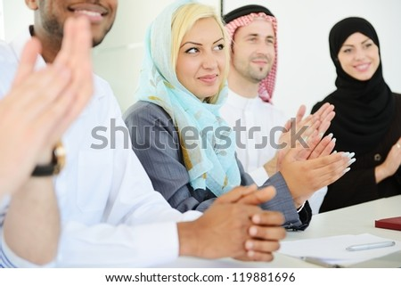 Group of  business people applauding during presentation - stock photo