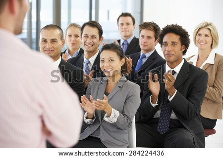 Group Of Business People Applauding Speaker At The End Of A Presentation - stock photo