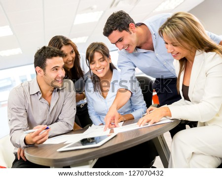 Group of business people at the office - stock photo