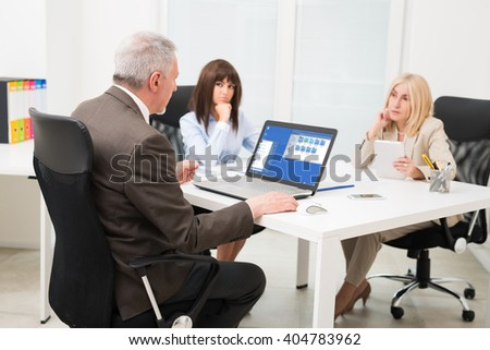 Group of business people at work in their office