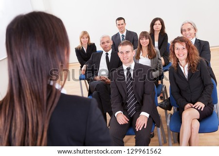 Group Of Business People Attending The Lecture - stock photo