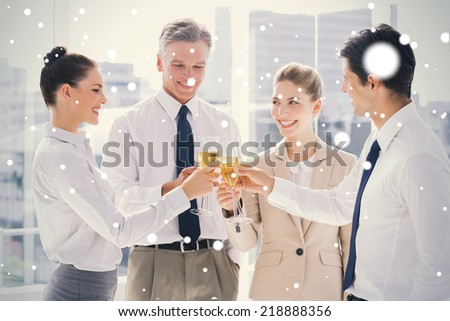 Group of business people clinking their flutes of champagne against snow