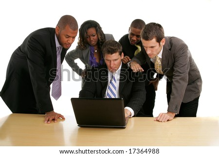 Group of business people clustered around a laptop working. - stock photo