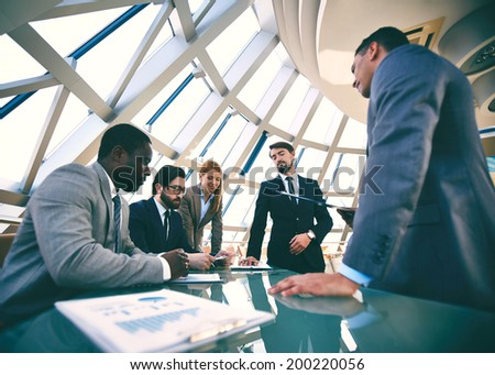 Group of business people discussing strategies at meeting - stock photo
