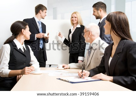 Group of business people discussing  the results of their work - stock photo
