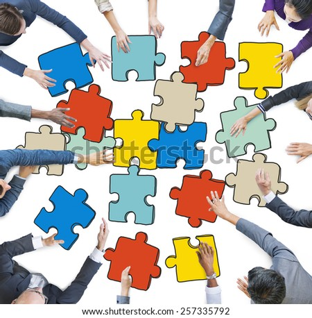 Group of Business People Forming Jigsaw Puzzle - stock photo