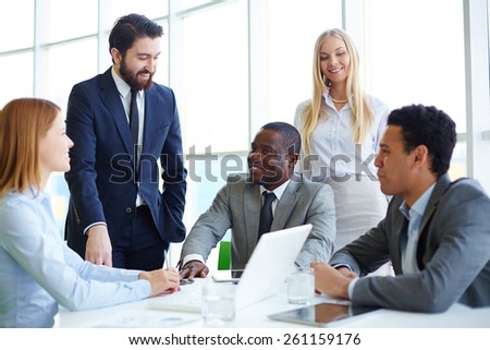 Group of business people gathering and communicating - stock photo