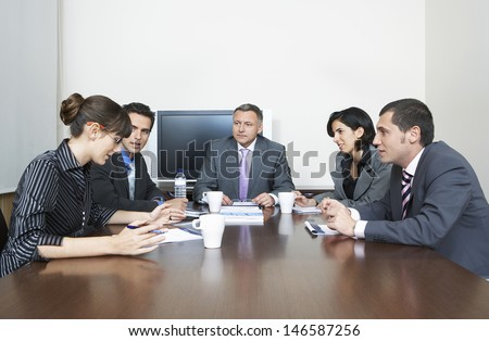 Group of business people having a discussion in conference room - stock photo