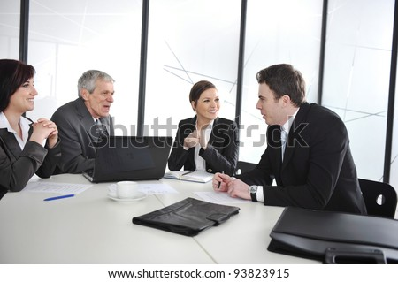 Group of business people having a discussion in office