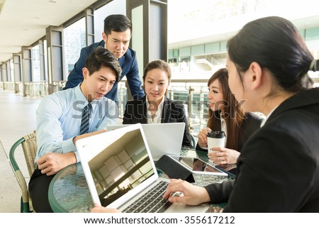Group of business people having meeting at coffee shop - stock photo