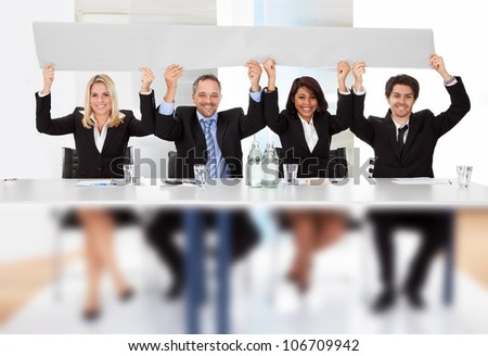 Group of business people holding empty placard - stock photo