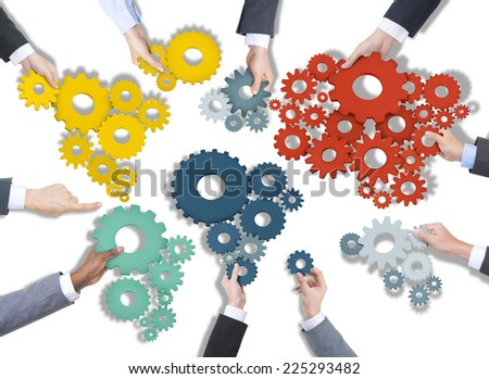Group of Business People Holding Gears - stock photo