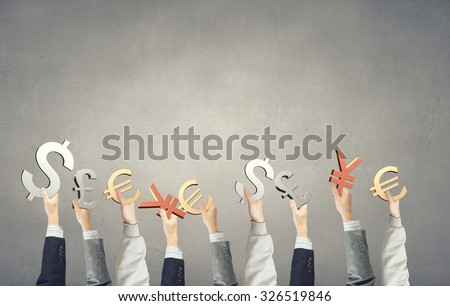 Group of business people holding money currency signs - stock photo
