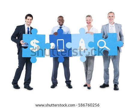 Group of Business People Holding Puzzle Pieces Different Icons - stock photo