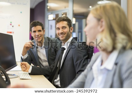 Group of business people in a modern office, working on computer - stock photo