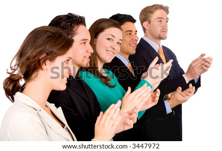 group of business people in an office applauding and smiling at success - focus is on the girl looking at the camera - isolated over white - stock photo