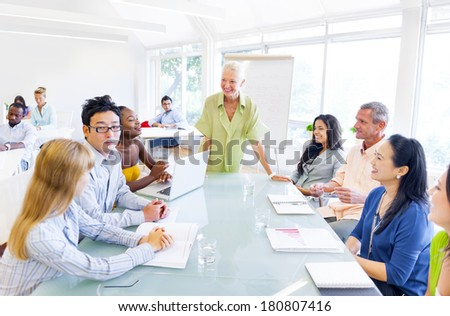 Group of Business People in Meeting - stock photo