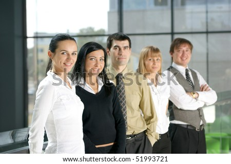 Group of business people in modern interior. Warning! Very low depth of field - stock photo