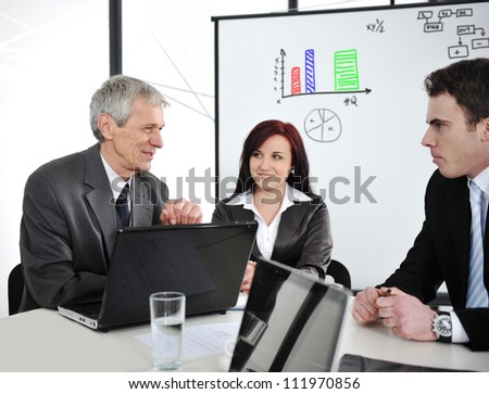 Group of business people in office at presentation - stock photo