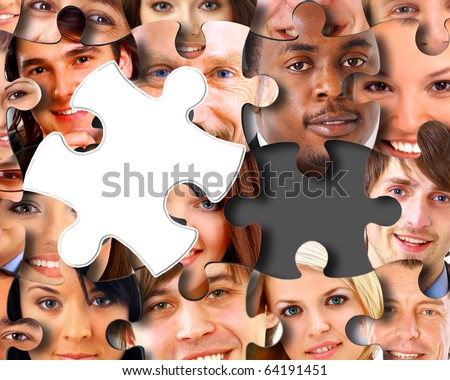 Group of business people in pieces of a puzzle - stock photo