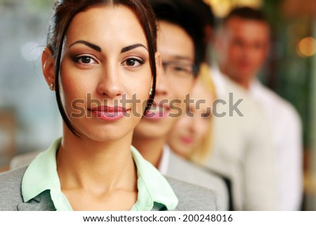 Group of business people in the office lined up - stock photo