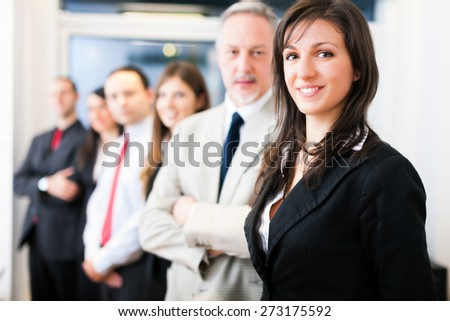 Group of business people in their office - stock photo