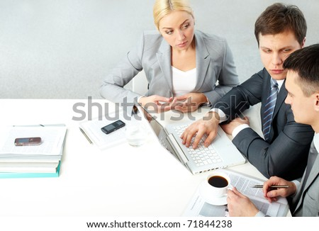 Group of business people interacting at meeting - stock photo